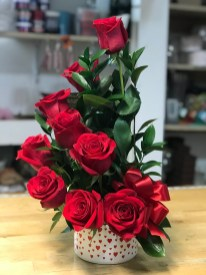 LVRE015-Red roses, green leaves and red ribbonSpecial: $48.99