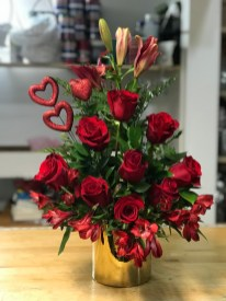 LVRE018- Lilies, red roses, red astromelias, with a beautiful red hearts on a gold round ceramic vaseSpecial: $80