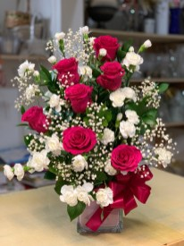 LVRE024- Hot pink roses combined with white mini carnations and baby breathSpecial: $75.00