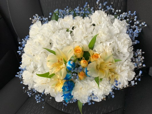 FNR019 Gasket pillow with white cushion, spray orange and blue roses, with blue baby breathe. $65.00