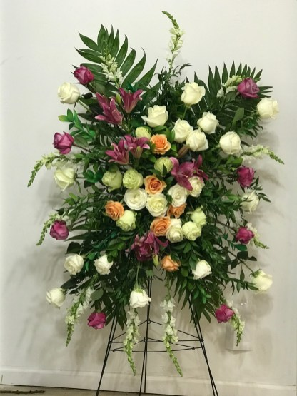FNR024 White with purple asiatic Lillies, green, mango and white roses. $275