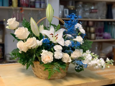 FNR022 Condolences basket with white Lillies, white roses and blue baby breathe. $95.00