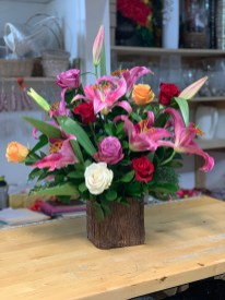 LVRE009-Lilies and roses in a woody vase $135.00