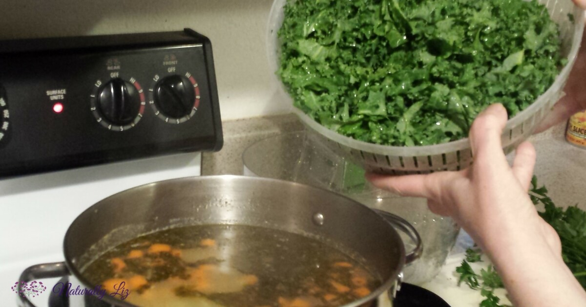 Adding Kale into Stewing Hen Chicken Vegetable Soup with Kale