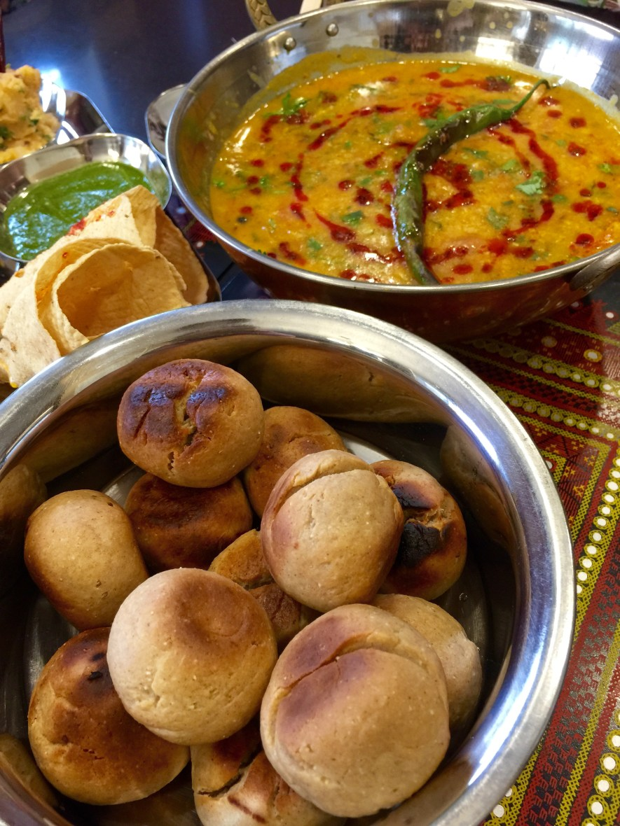 This iconic Rajasthani dish, Dal Baati features charcoal grilled baati, triple lentil dal and churma. Serve it with some smoked green chilies, aloo bharta, chutney and kuchumber salad for a wholesome and healthy version of an Indian classic!