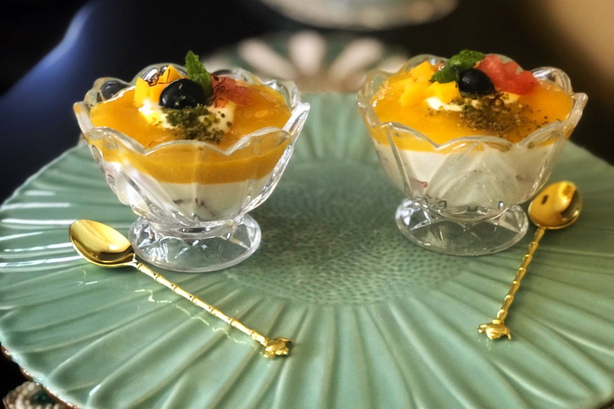 Watermelon Mango Shrikhand - cold, refreshing, creamy and absolutely delicious! A traditional saffron and cardamom Shrikhand made with rich, creamy yogurt, but with a twist of seasonal fruits. Diced watermelon in the yogurt and a layer of mango puree on the top, make this impeccable dessert modern, perfect to beat the summer heat, and even more irresistible!