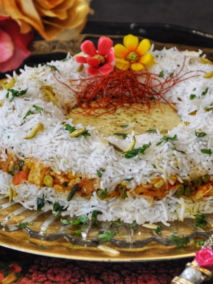 Vegetable Badam Tehri (Biryani), an aromatic dish from the era of royal Indian kings. It is a medley of delectable flavors and appetite inducing aromas with a variety of soft-sweet vegetables, long grain rice, authentic spices and rich almond paste. Perfect for a party or festive occasion.