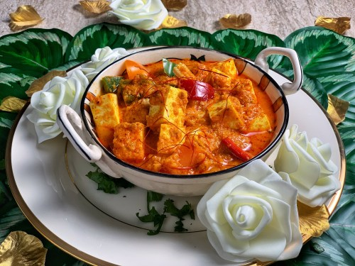 Instant Pot Paneer Coconut Masala - an Asian inspired twist on the timeless Indian classic, this paneer in coconut gravy is a harmonious blend of coconut milk and tomato, all at once. The crisp bell peppers, baby corn, and onions give it a lovely freshness and make it the perfect curry dish! Enjoy this with paratha, naan bread or rice!