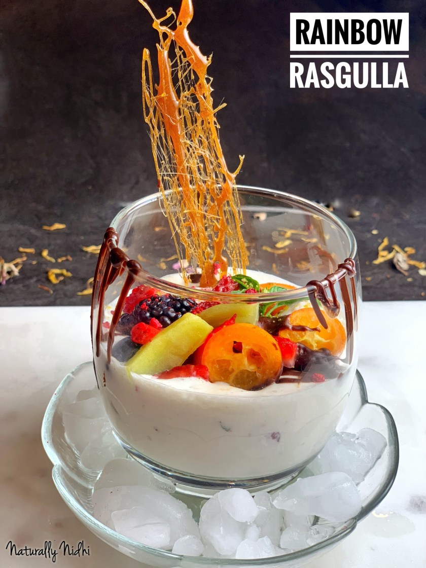 This Rainbow Rasgulla is bursting with flavors, textures, and colors, just in time for Holi! With fluffy rasgullas perched in a vanilla ice cream base with fresh fruits and chocolate to top it off, the decadence of this fun twist on a classic dessert is undeniable!! Serve this dessert to your friends or families this Holi to add some color to their day!