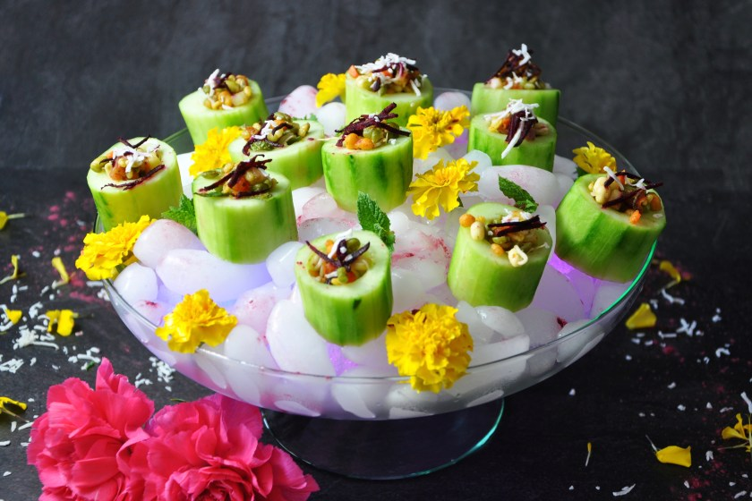 These cucumber cups with a dynamic filling of veggies, dates, spices, and chutneys are the ultimate appetizer for a burst of tangy, crunchy flavors! The filling has dates, carrots, sprouts, and onions paired with chaat masala, and lemon for an innovative spin on almost a vegetable chaat!