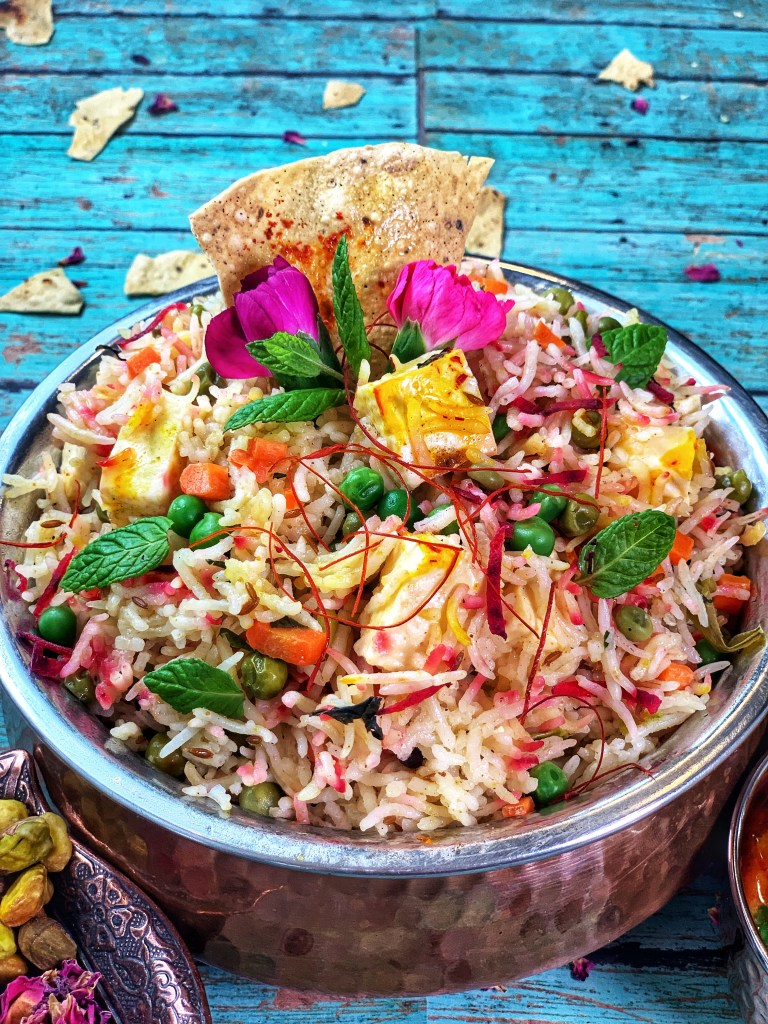 Dotted with aromatic spices like cardamom, cumin, and biryani masala, this Instant Pot Saffron Rose Biryani is a dish fit for kings! Super rich and luxurious, it has paneer, beets, and peas for a rice dish that's full of complex textures and flavors! Serve it for dinner parties or make it for busy weekday meals and no one will know just how easy this dish is!