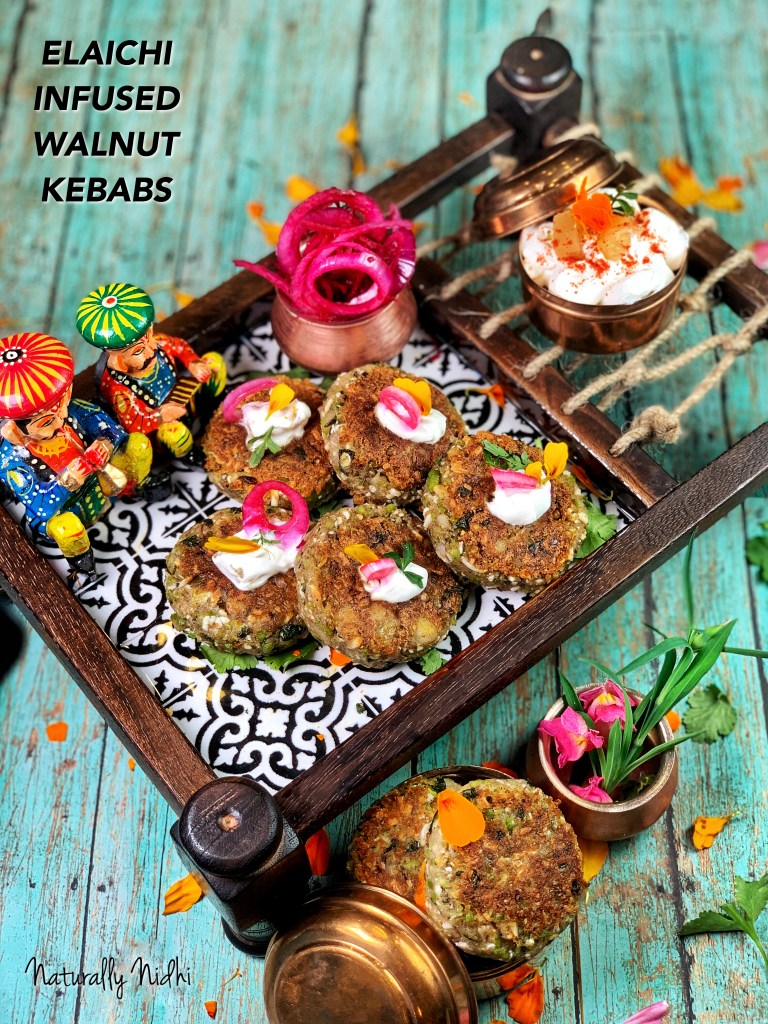 Elaichi-Cardamom Infused Walnut Kebabs with a smoky cardamom flavor and melt in your mouth texture are a perfect appetizer this winter season! Made with peas, paneer, walnuts, and potatoes, and paired with a pineapple yogurt dip, the balance of spicy and sweet flavors are irresistible!