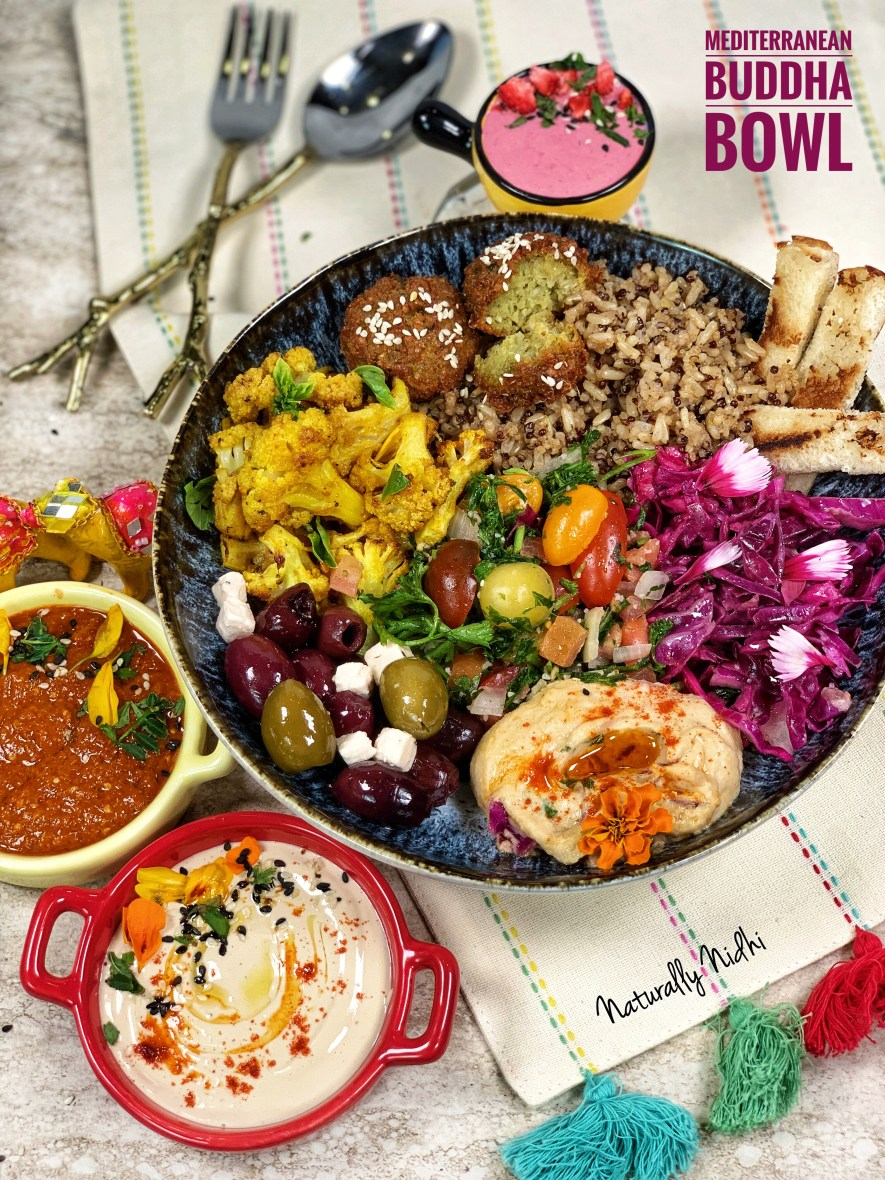 This healthy Mediterranean Buddha Bowl with roasted cauliflower, falafels, hummus, beetroot tahini and a medley of vegetables is served with quinoa brown rice. Packed full of flavors, this is an easy to make recipe for a nutritious meal!