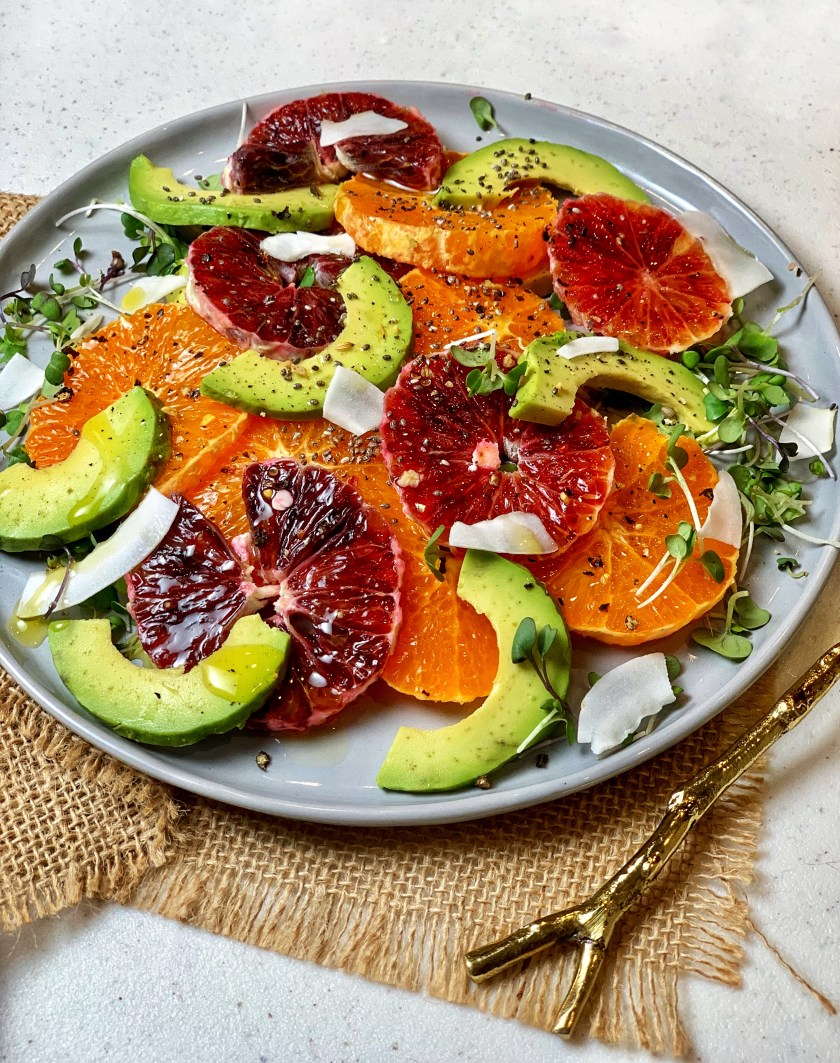 Orange Avocado Salad - a simple snack to keep your immunity levels high during those late afternoon pangs! It's a quick mix of blood oranges, avocado, and basil with a simple dressing of honey, extra-virgin olive oil, and spices on a bed of microgreens!