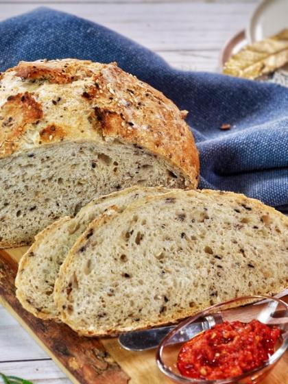 No Knead Multiseed Bread - easy to make, nutritious bread that requires no kneading. With a moist interior, crunch from the seeds (flax, chia, hemp, sesame), and lots of fiber, try this homemade dutch oven bread.