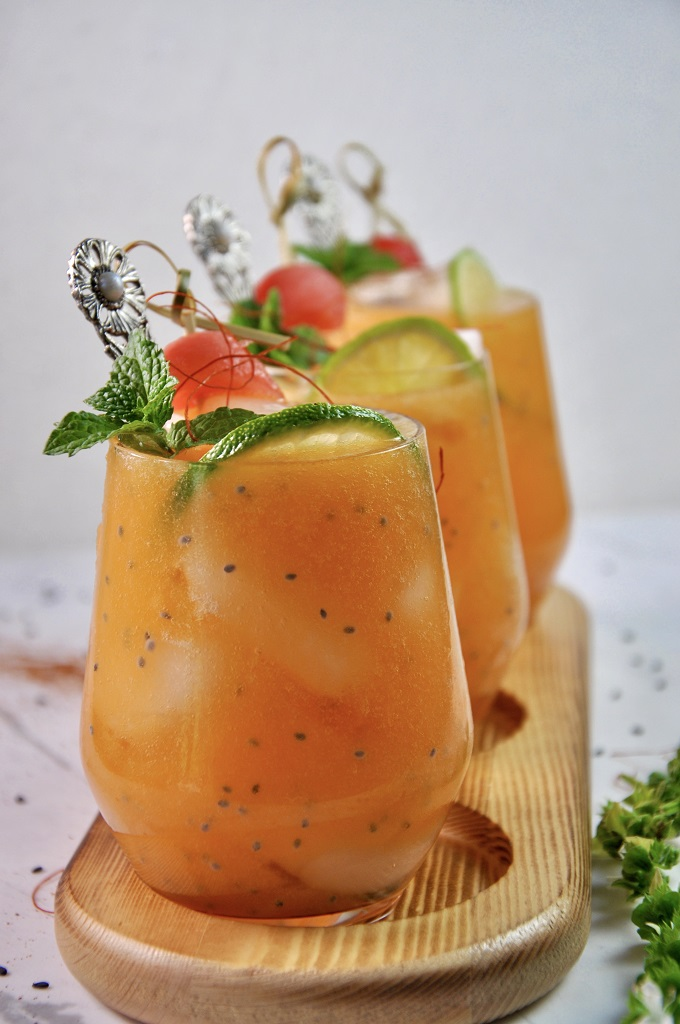 As the temperatures rise and the summer sun remains high in the sky, there's nothing like a refreshing Cantaloupe Agua Fresca! Perfumed with mint, naturally sweetened with honey, and served on the rocks, this simple summer refresher is a quick and fancy step-up from a regular bowl of fruit! It's is a refreshing drink, super popular in Mexico and Central America and has virtually endless flavor combos you can try!