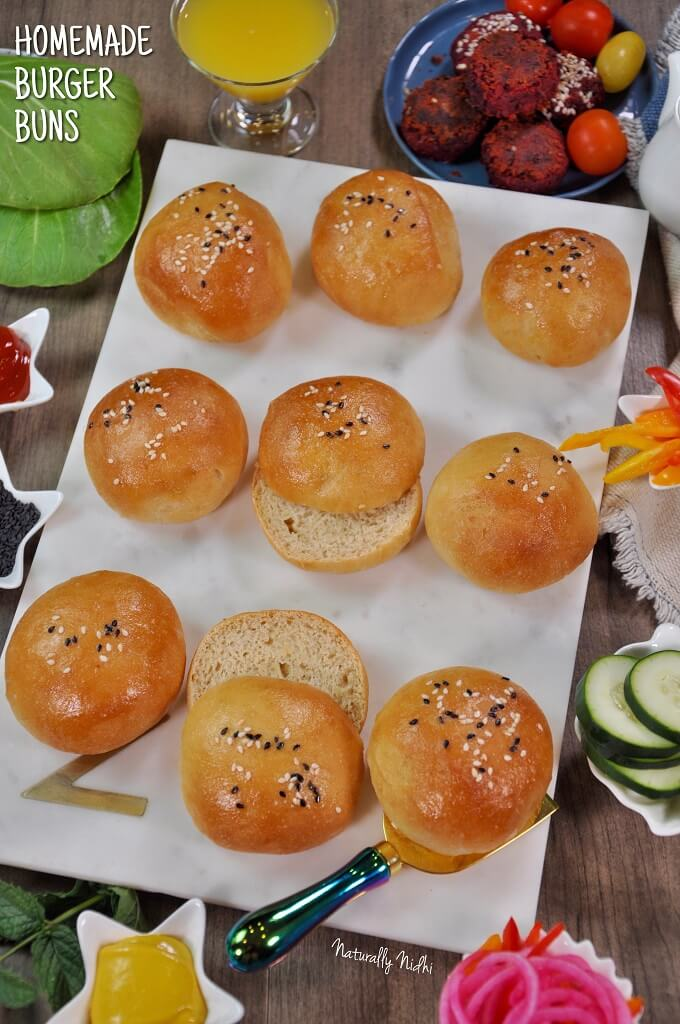 Super fluffy and golden brown, these eggless burger buns are a super easy homemade bread. Enjoy them as a burger or a dinner roll and you'll never go back to store bought after trying these classic buns!
