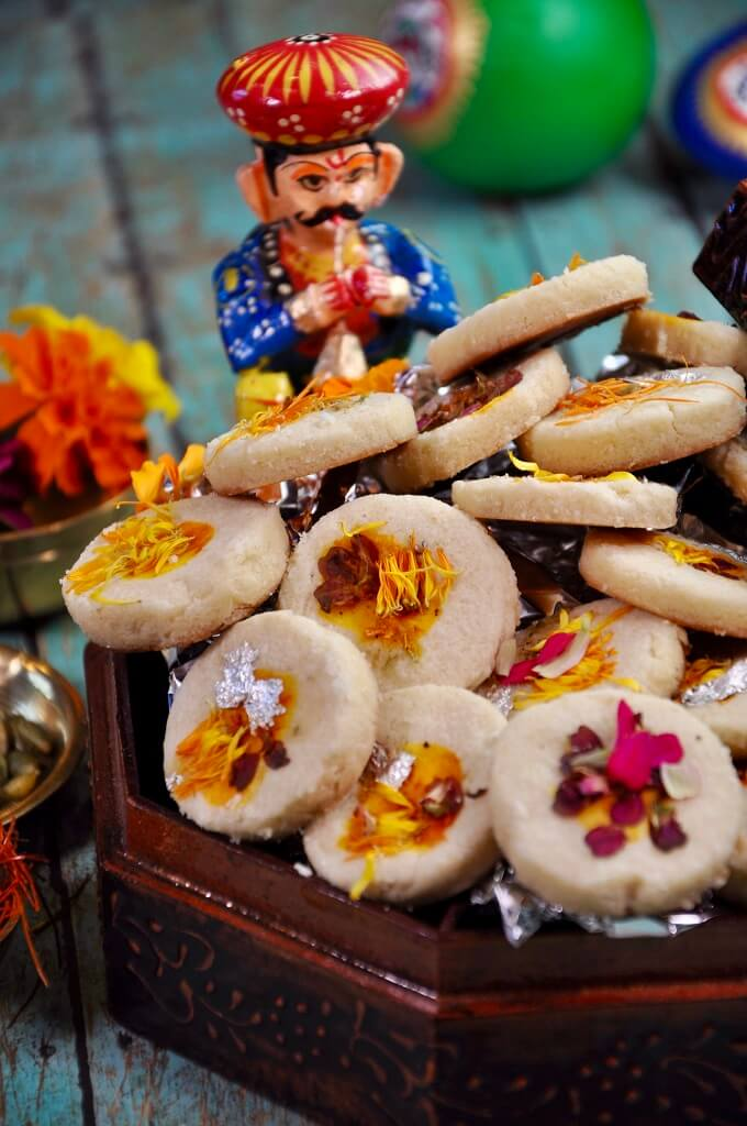 A delicate sugar cookie garnished with edible flowers and strands of saffron, this Mishri ki Roti is a delicious sweet treat! Made with a few simple ingredients, it's sure to be a family favorite!