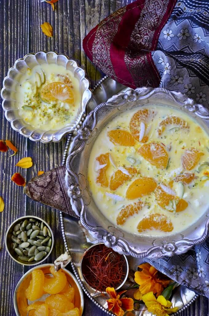 Orange Kheer - a fruity twist on the classic rich and velvety pudding with oranges and chenna (crumbled paneer). Flavored with cardamon and saffron, this royal dessert is perfect for the festive season!