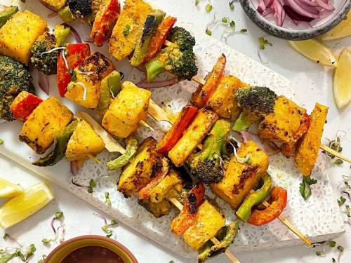 Grilled Pineapple Skewers - Kickoff the big game this Sunday with these juicy, tangy, and deliciously caramelized hawaiian skewers. With sweet pineapple coated in spiced mint marinade, you're guaranteed to bring the heat to this year's Super Bowl!