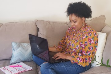 Woman working from home on the couch | Naturally Stellar