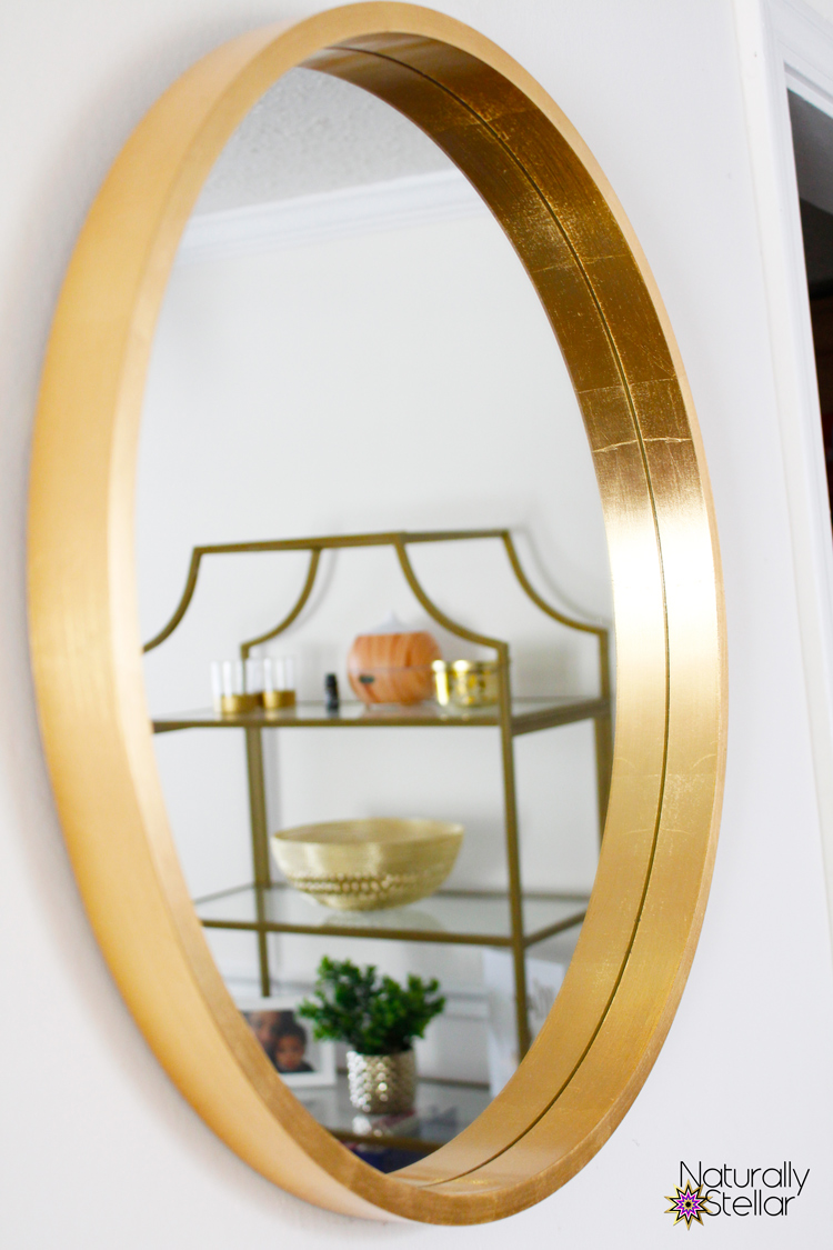 Brushed gold mirror adds depth to small room | Naturally Stellar