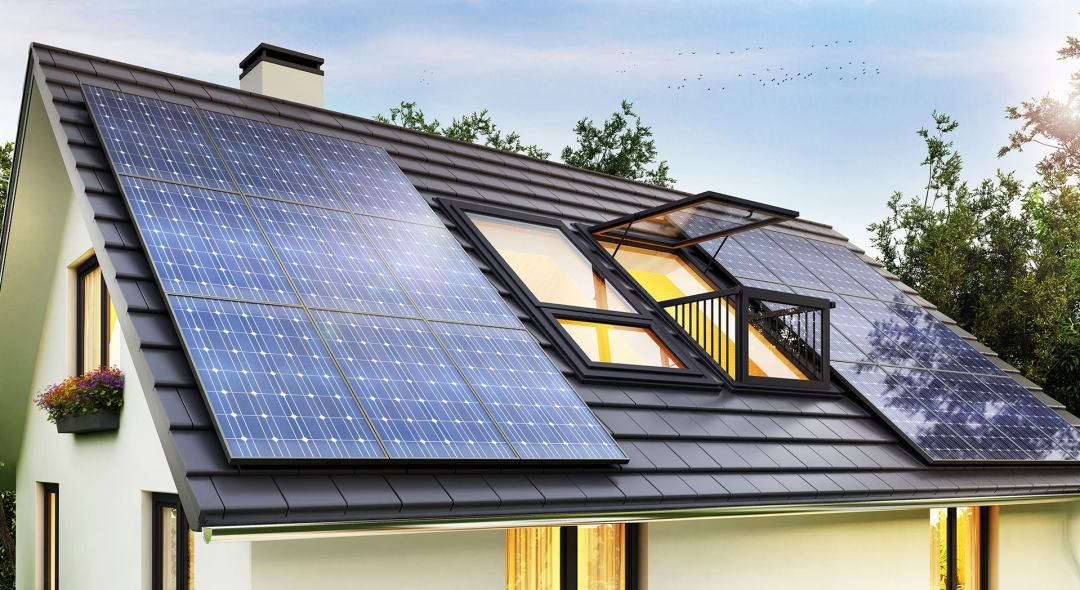 a steep roof with dark shingles, solar panels and a balcony