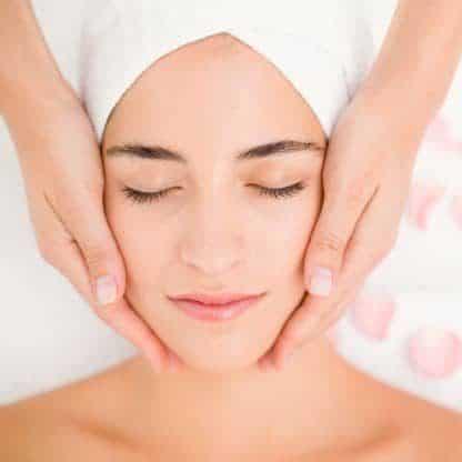 attractive woman receiving facial massage spa center 13339 256034 e1550949595894