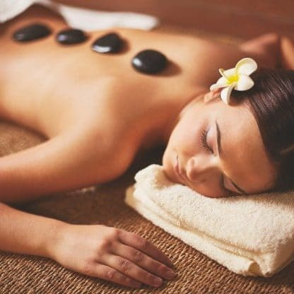 woman enjoying stone massage 1098 3182 e1550949548579