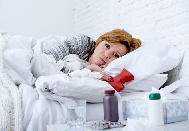 Sick-Woman-Lying-On-Bed