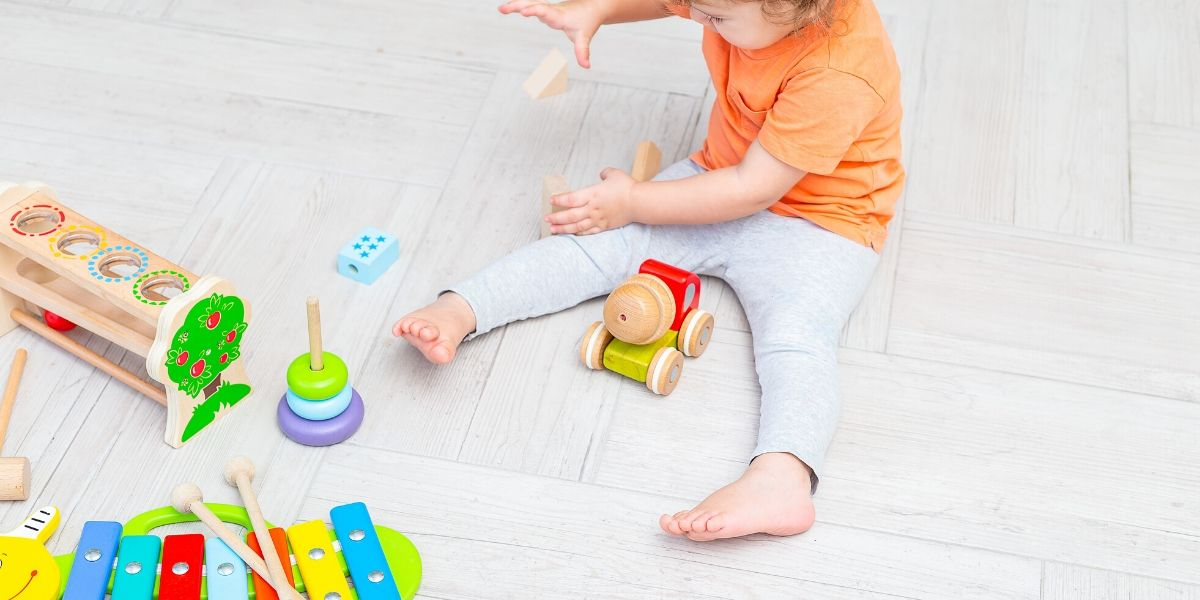 CHILD WITH WOODEN TOYS