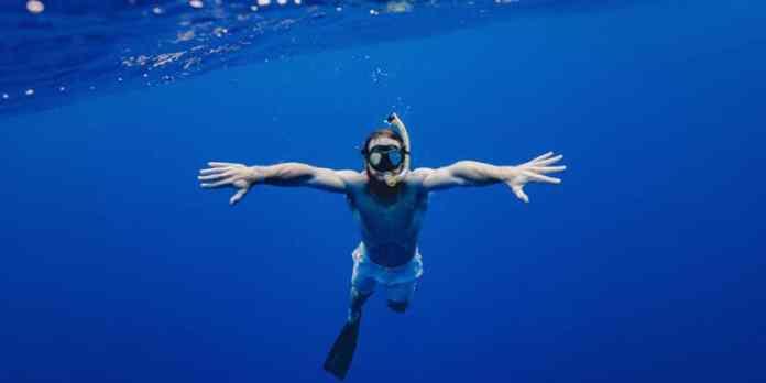 Segurança na praia - Não superestime sua natação foto