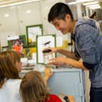 Mike Yuan teaches kids about anoles at Cal Day 2018 in the MVZ.