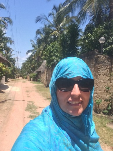 A Kenyan woman told me this is how Muslims in Mombasa wear their wraps and fixed me up accordingly. It definitely helps keep the hot African sun off you.  Our house is on this lane.