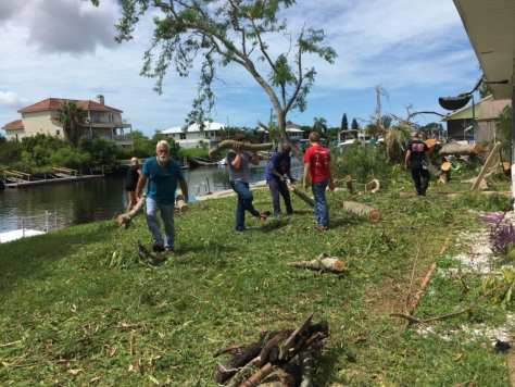 Hernando Beach residents and local volunteers work together to clean up residential debris.
