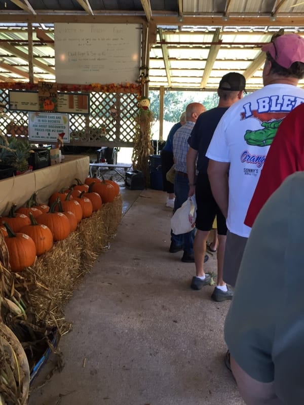 Locals and visitors gladly wait in line to pick their fresh Frazier corn.