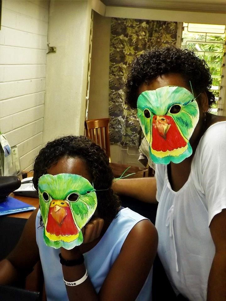 Two NatureFiji-MareqetiViti staff wearing Kulawai masks