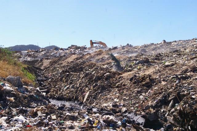 smoking dirty landfill