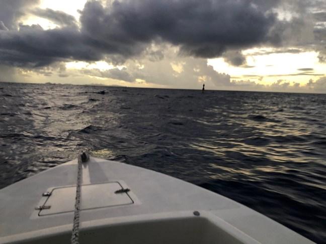boat at sea at dawn