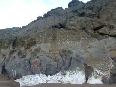 Band of white calcite at base of Mewslade cliffs along a fault line
