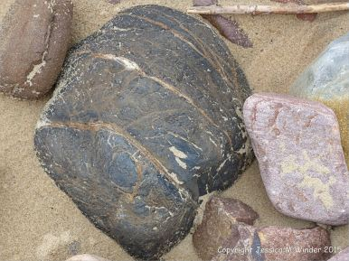 A beach stone made of iron on the Gower Peninsula in South Wales