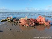Brightly coloured tangle of flotsam fishing nets