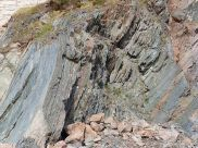 Phyllite rock showing almost vertical fine layers in cross-section view on the Cabot Trail in Cape Breton Island