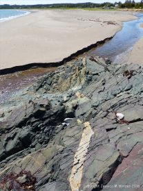 View from the basalt outcrop across the beach at Main a Dieu, Cape Breton Island, Nova Scotia, Canada.