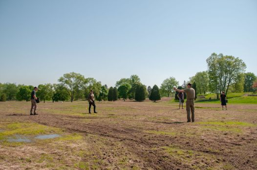 Working with volunteers to seed the prairie at The Highlands
