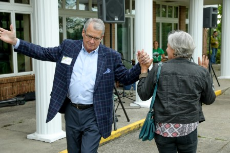 Campaign co-chairs David Morgenstern and Marti O'Brien dance at the Highlands Community Celebration. Photo by M-Buck Studio.