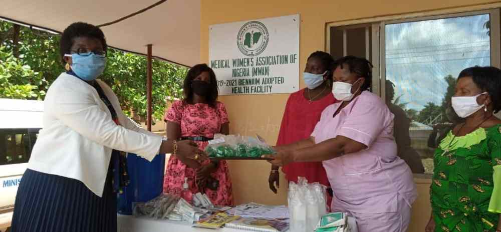 Covid-19 Palliatives: Medical Women's Association of Nigeria (MWAN), National Secretariat Led By Its President, Dr. (Mrs) Minnie Oseji donates medical items As Palliatives of Behalf of the Association to Primary Health Care