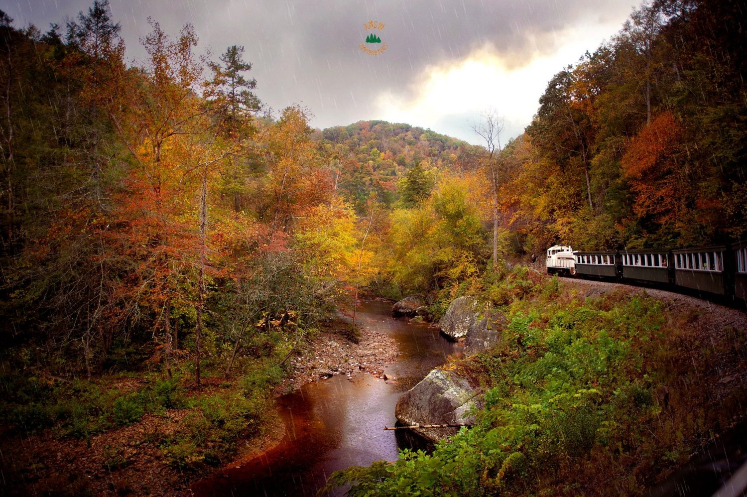 fall color in the Appalachian river valley from a train