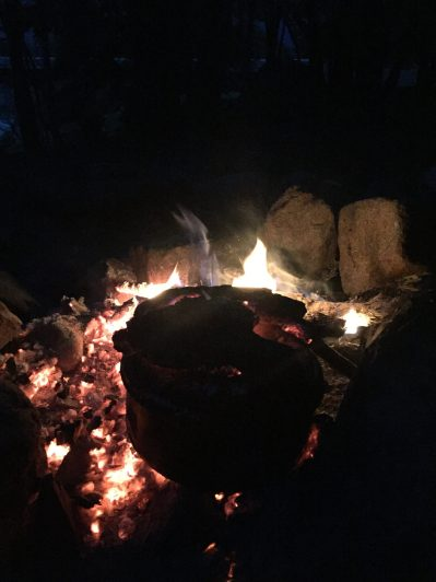 Cooking dinner over the fire