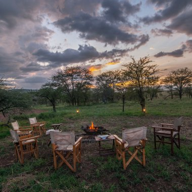 Camp-fire-sunset-on-safari-in-Tanzania